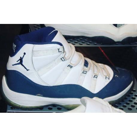 white and navy blue jordans